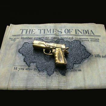 Newspaper and a gun - Kanta Kishore Moharana - statue